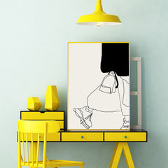 Fashion line art poster print by Sophia Novosel, with an abstract woman, in black and grey, framed in office