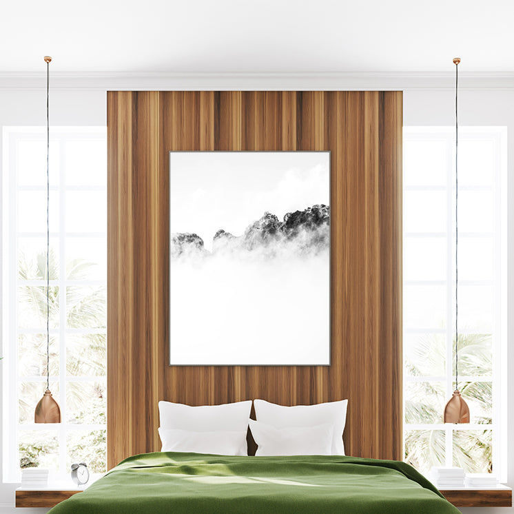 Black and white photo poster print with a bird flying over cloudy mountains, in bedroom