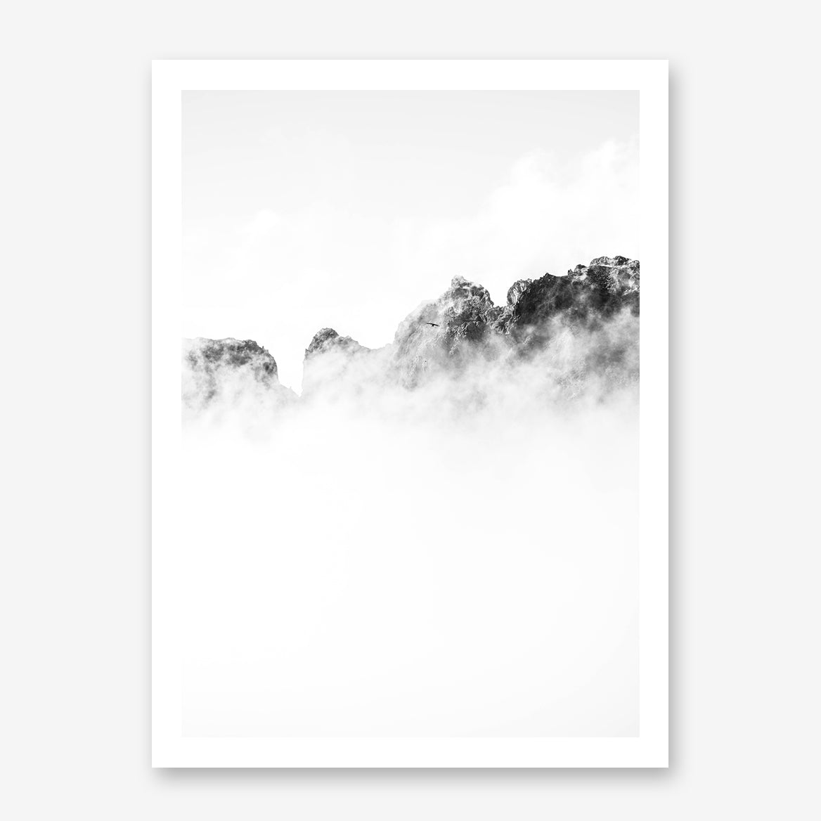 Black and white photo poster print with a bird flying over cloudy mountains