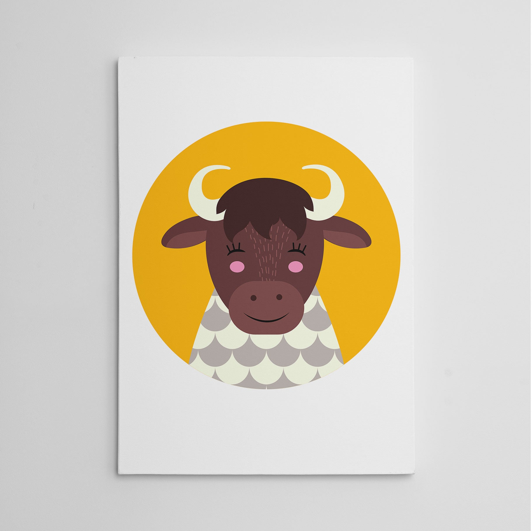Nursery canvas print with a smiley cow in a yellow circle.