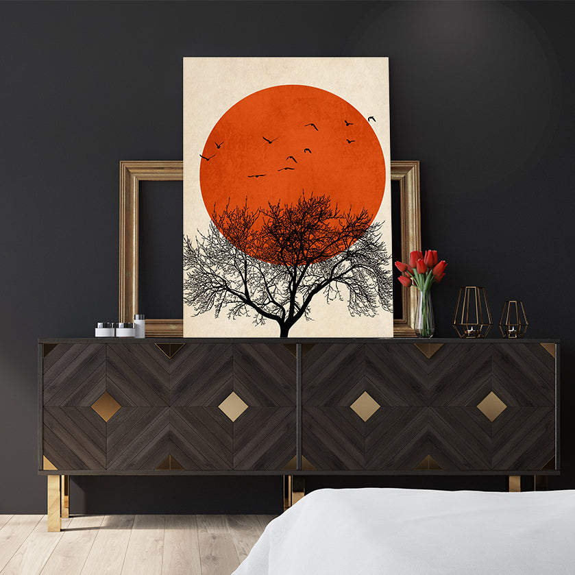 Illustration print by Kubistika, with black tree and birds, and dark orange sun, on textured beige background; bedroom view