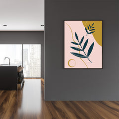 Illustration poster print with green leaves, on pink and mustard coloured background, framed view