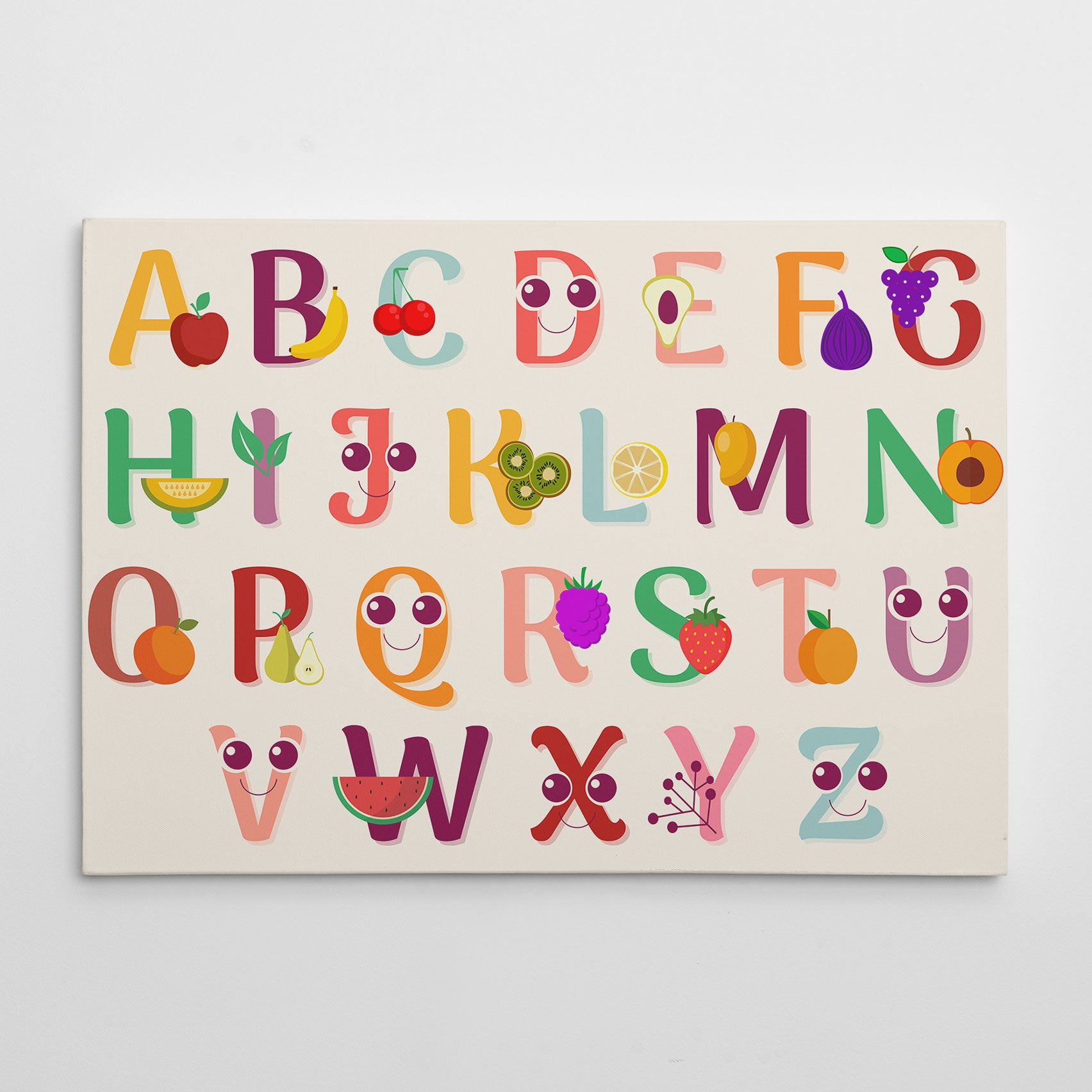 Canvas print with colourful alphabet letters and fruits, on light pink background.