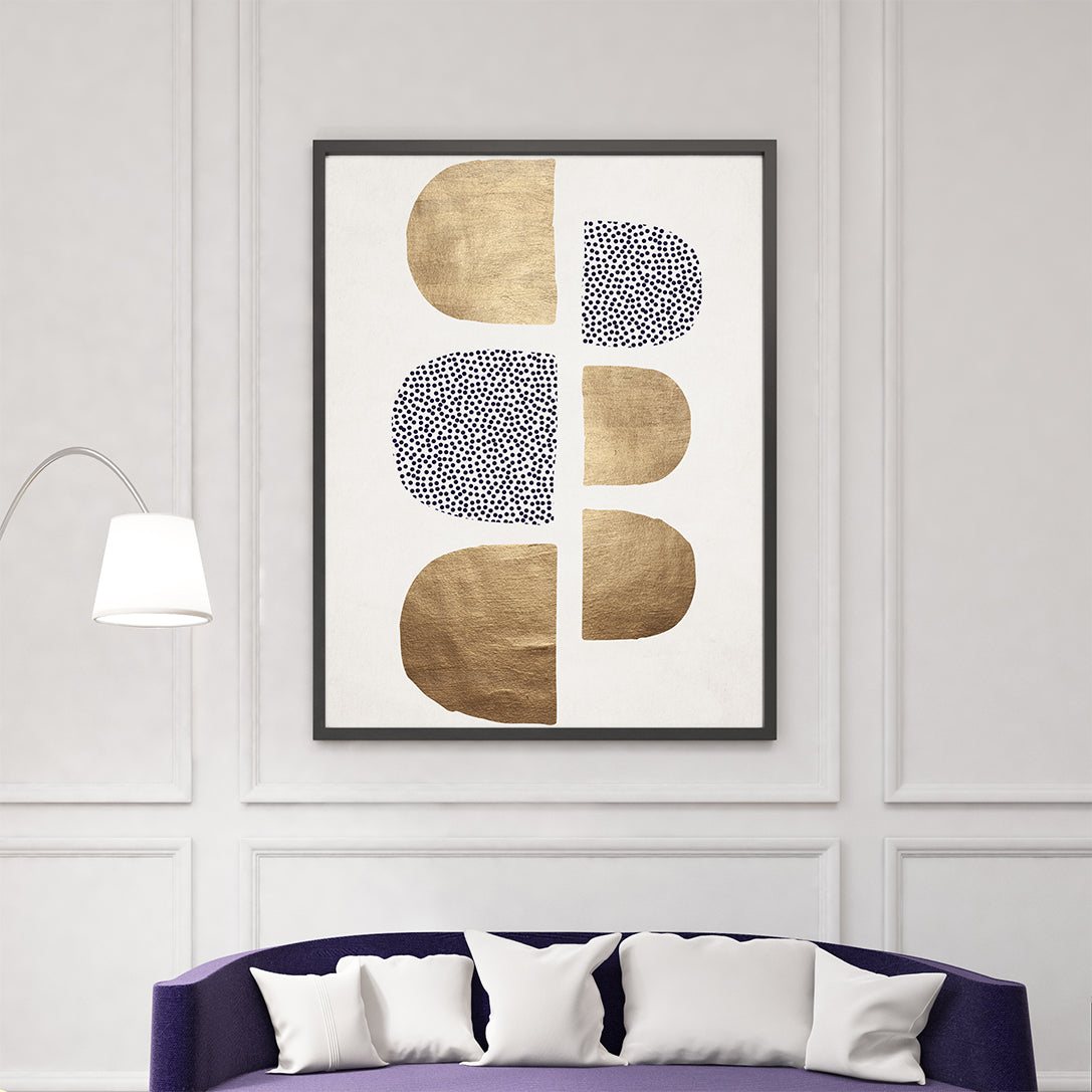 Abstract poster print by Kubistika, with textured gold and purple dots shapes, on light grey background, living room view