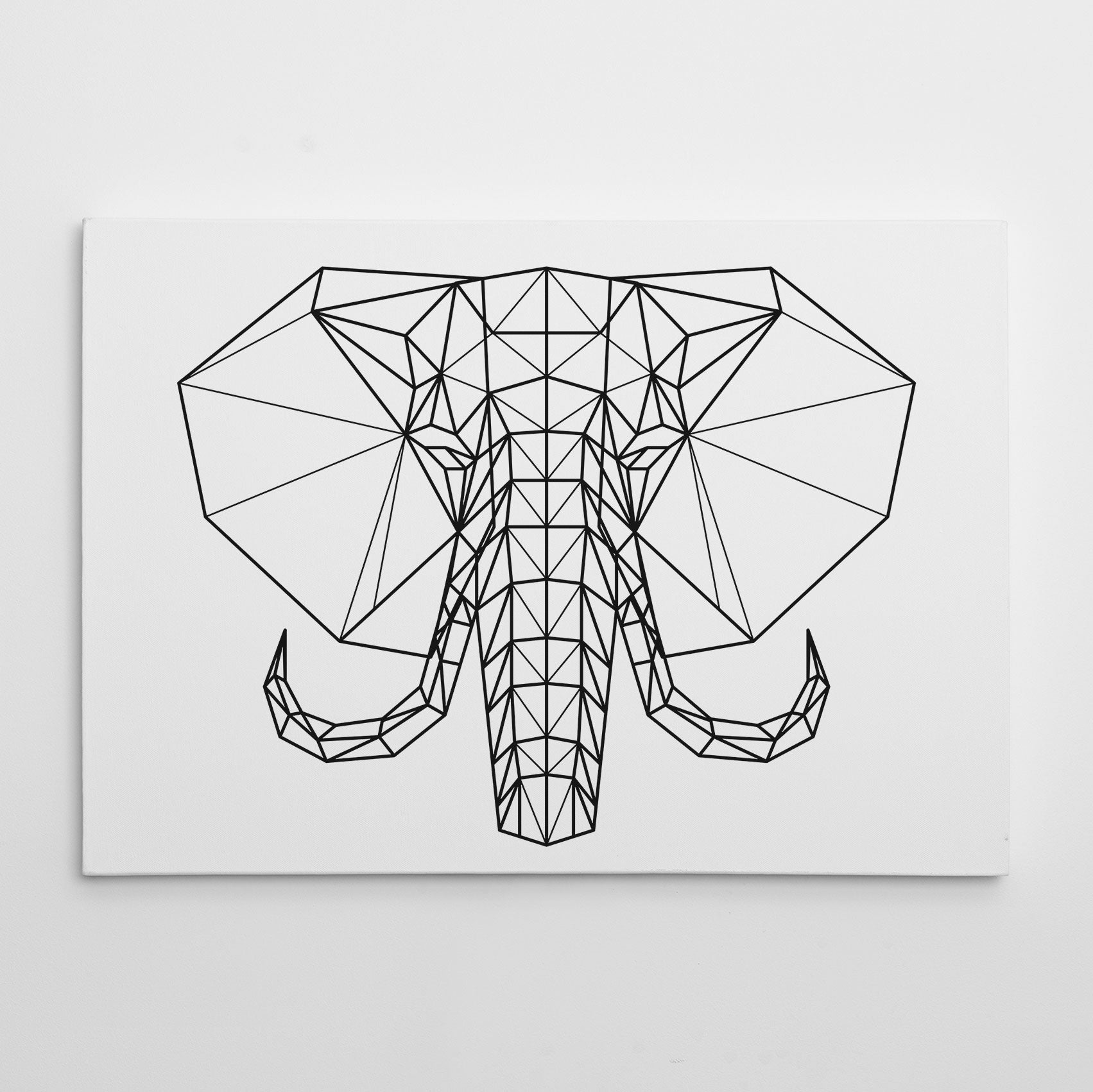 Geometric canvas print with black and white elephant head.