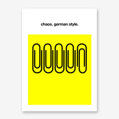 Typography poster print by Kubistika, with black paper clips and text 'chaos. German style', on white and yellow background.