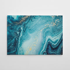 Abstract canvas print with gold and light blue paint mix.