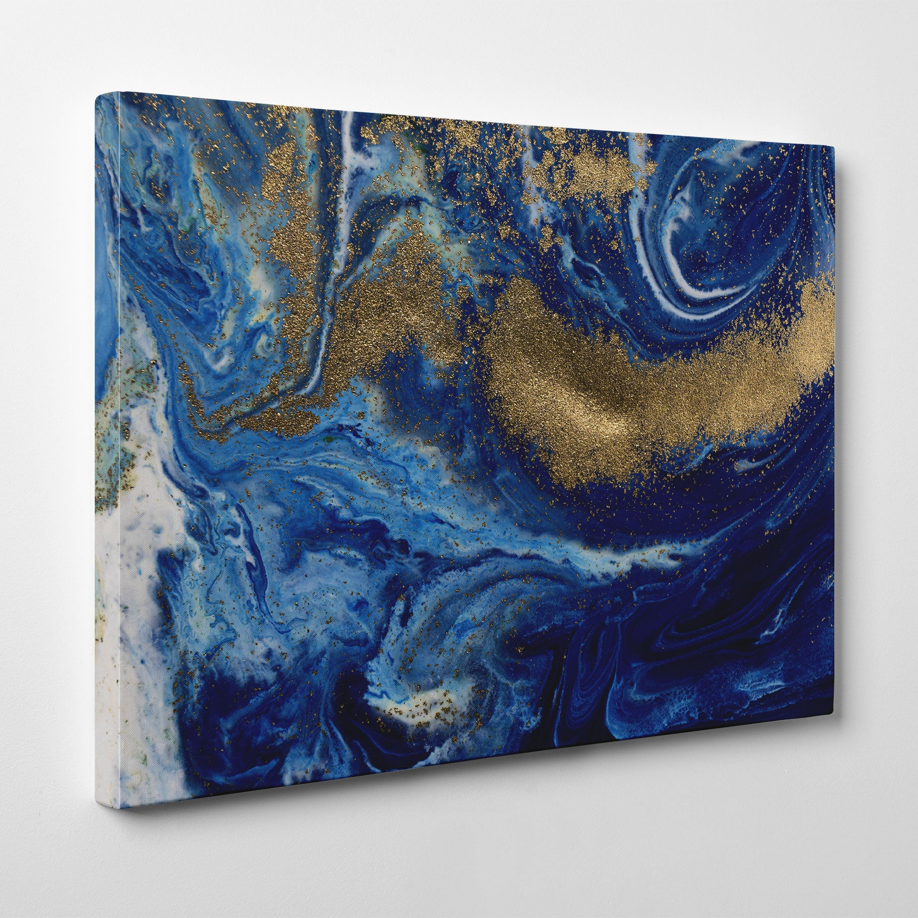 Abstract canvas print with gold and blue paint mix.