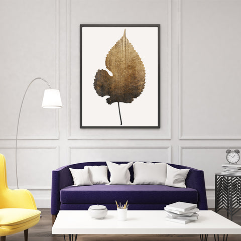 Botanical poster print by Kubistika, with a large textured golden leaf, on light grey background; in living room