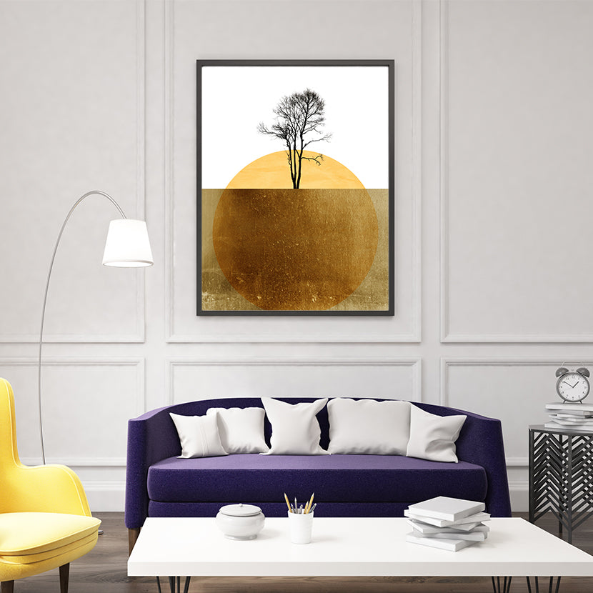 Abstract poster print by Kubistika, with yellow sun and black tree, on white and gold background; in living room