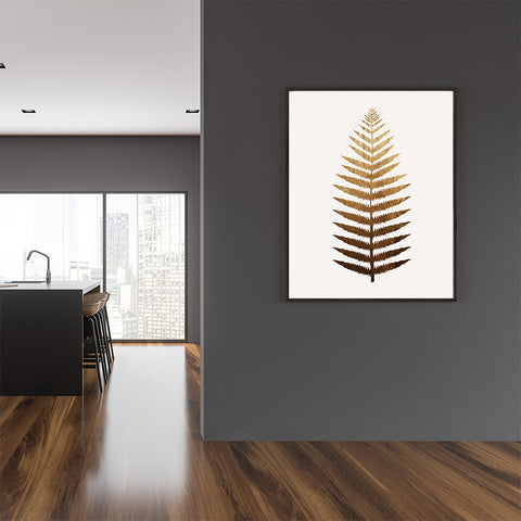 Plant poster print by Kubistika, with a large golden leaf, on light grey background, in kitchen.