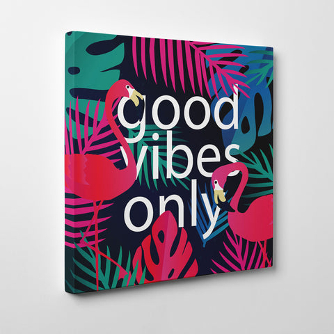 "Illustration canvas print with colourful leaves, pink flamingos and white text ""good vibes only""- side view"