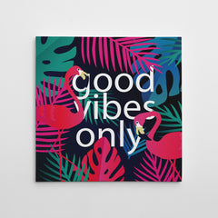 "Illustration canvas print with colourful leaves, pink flamingos and white text ""good vibes only""."