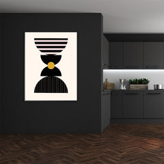Graphic art poster print with black, pink and mustard shapes, on light peach background, dining room view