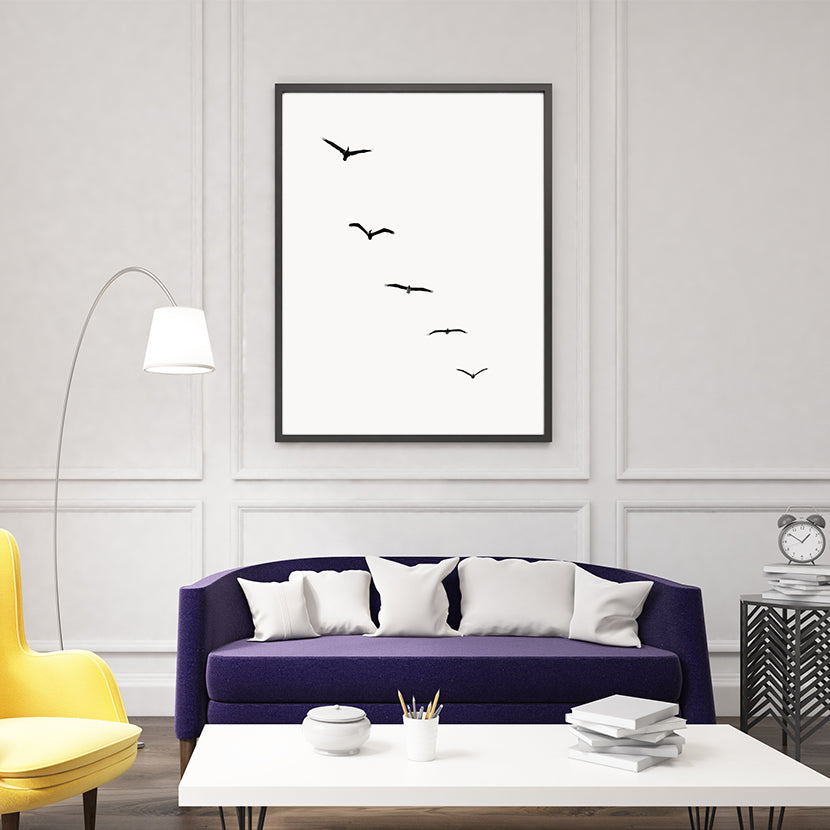 Poster print by Kubistika, with black birds, on light grey background; in living room
