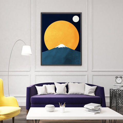 Illustration print with bright yellow sun, white moon and blue snowy mountain, on dark blue background; in living room
