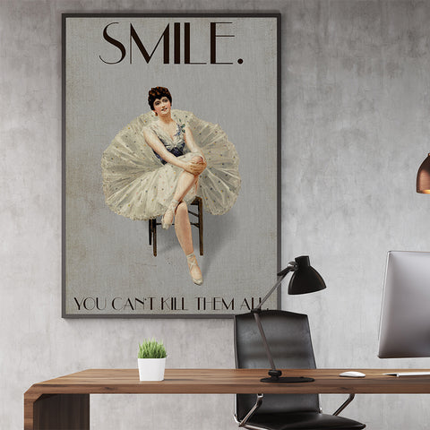Vintage poster print by Kubistika, with a ballerina smiling and the quote ''Smile. You can't kill them all'', on grey background, in office