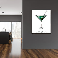 Kitchen poster print by Kubistika, with a green drink glass and quote 'this kitchen is for dancing', on white background; in dining room