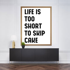 "Poster print with black text ""Life is too short to skip cake"", on white background, framed"