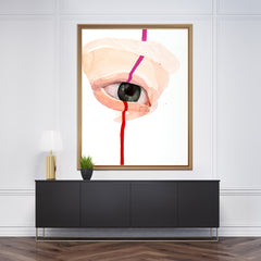 Minimalist poster print by Sophia Novosel, with a watercolour green eye, framed in living room