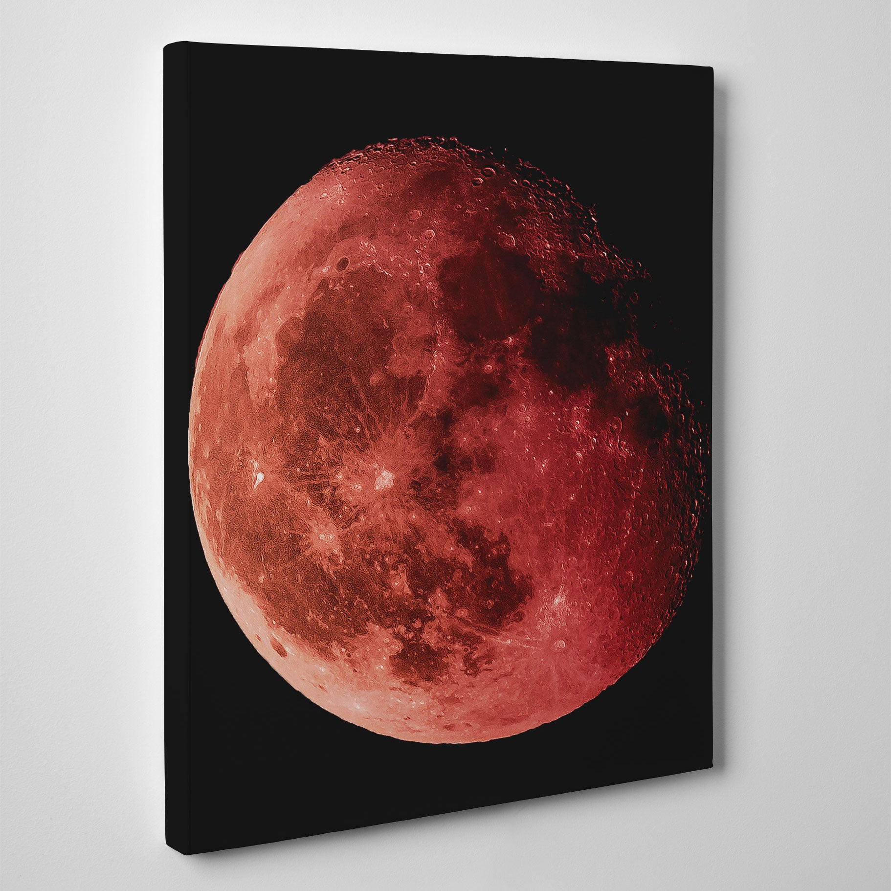 Geometric canvas print with red moon, on black background - side view