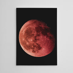 Geometric canvas print with red moon, on black background.