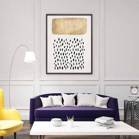 Abstract poster print by Kubistika, with gold and black shapes, on light grey background; in living room