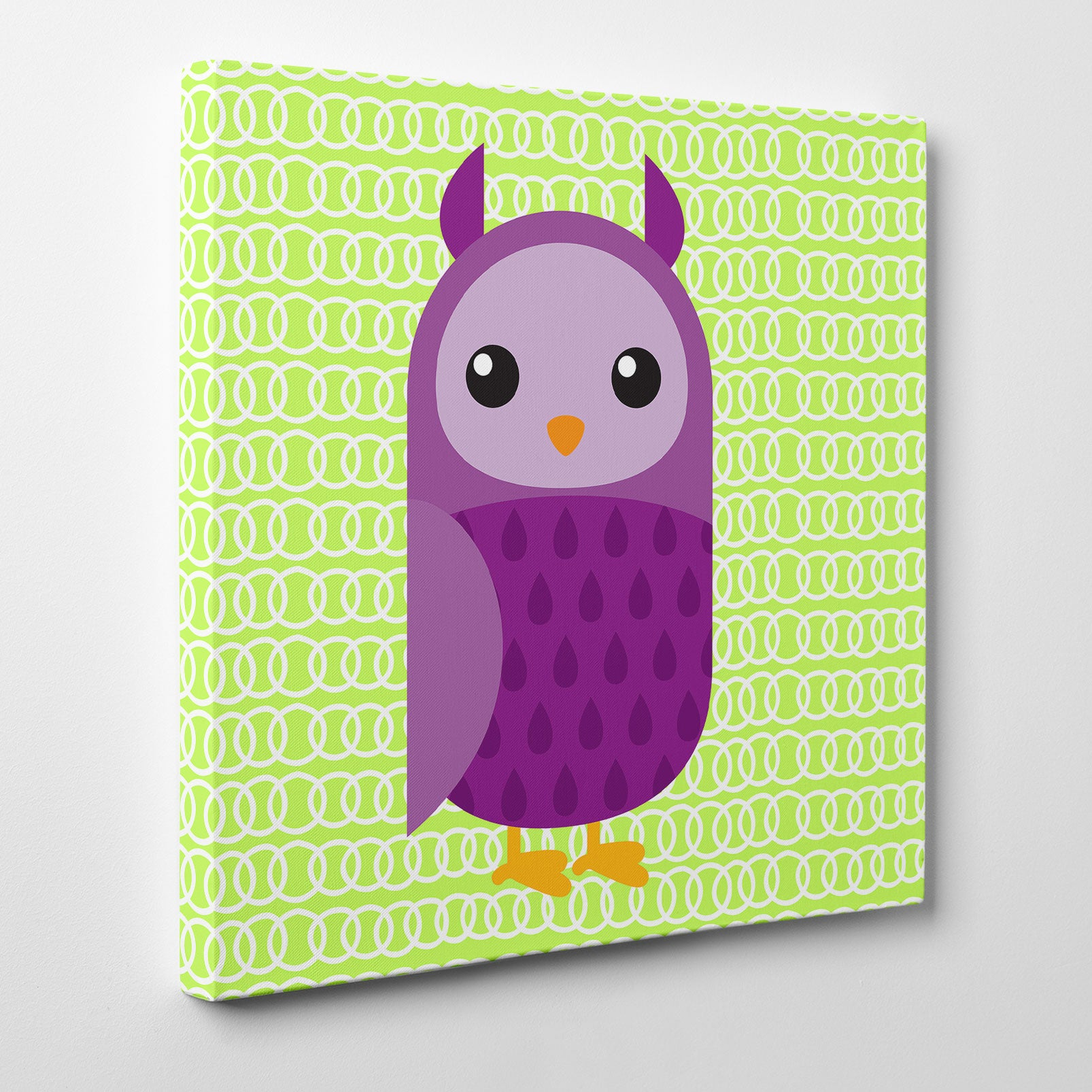 Canvas print with a purple owl on green patterned background - side view