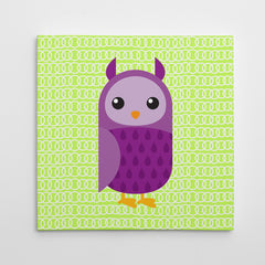 Canvas print with a purple owl on green patterned background.