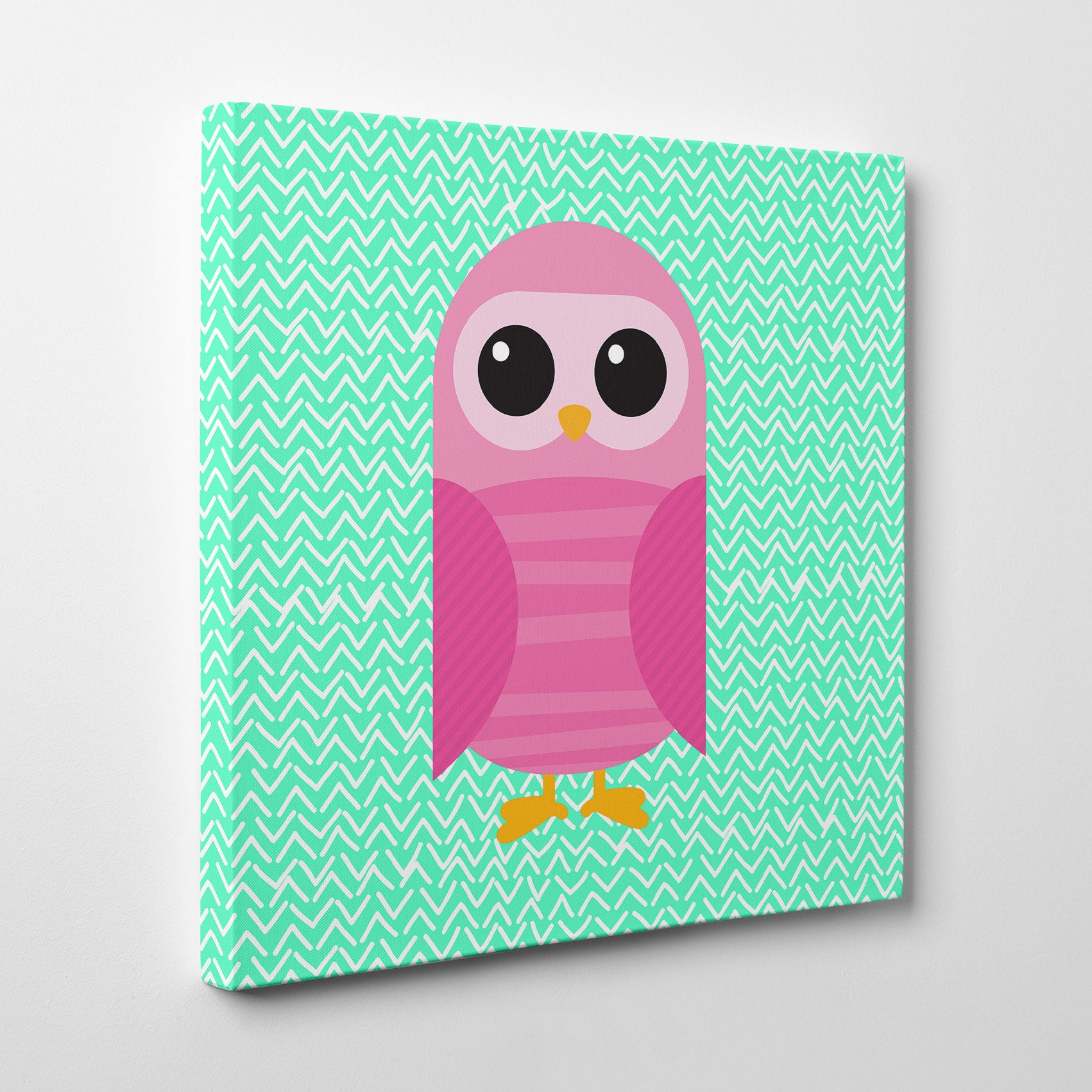 Canvas print with a pink owl on mint patterned background - side view