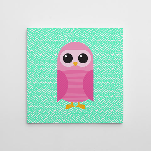 Canvas print with a pink owl on mint patterned background.