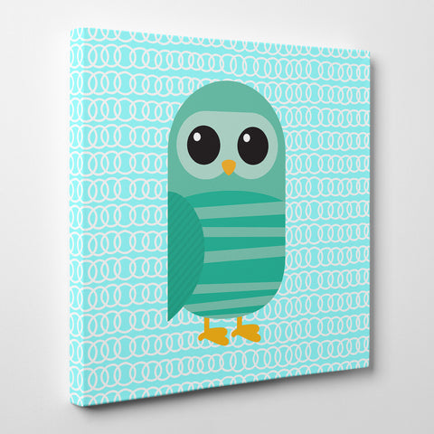 Square canvas print with a green owl on blue patterned background.