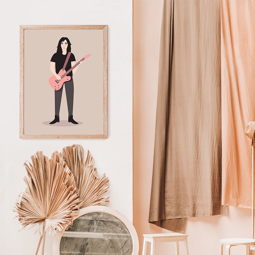 Celebrity illustration print by Judy Kaufmann, with PJ Harvey holding a pink guitar, on light brown background, in living room