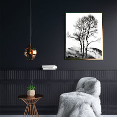 Black and white photography poster print by Kubistika, with foggy mountain behind tree; in hallway