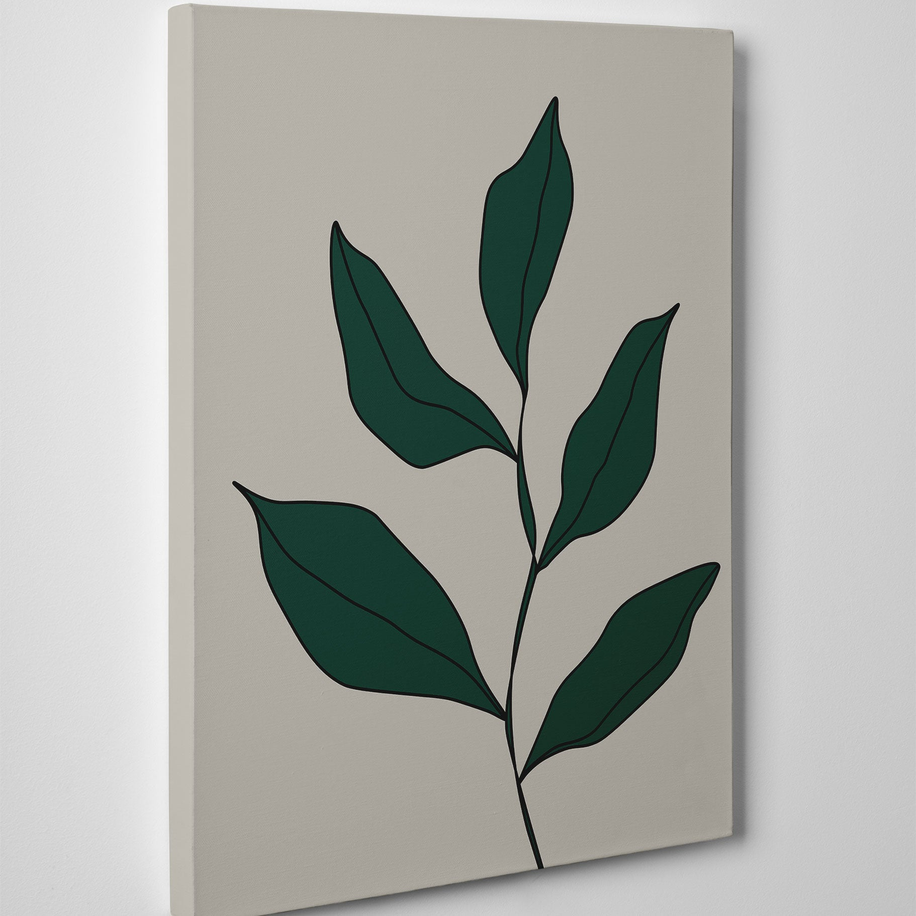 Abstract canvas print with green leaves on grey background - side view