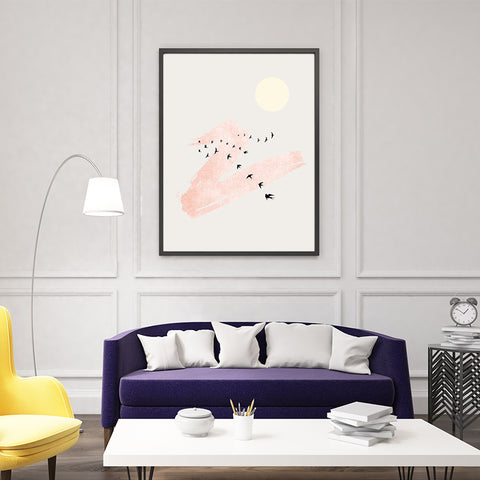 Minimalist poster print by Kubistika, with beige sun, black birds and rose pink brush stroke, on grey background, in living room