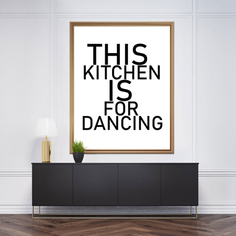 "Black and white typography poster print with ""This kitchen is for dancing"" bold text, framed"