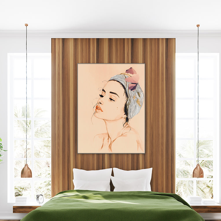 Fashion poster print with a woman's portrait with head wrap and leaves, framed in bedroom