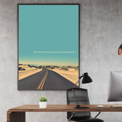 Inspirational  poster print by Kubistika, with a desert road, teal sky and quote 'the art of knowing is knowing what to ignore'; in office