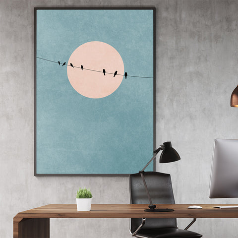 Minimalist textured poster print by Kubistika, with dusty pink sun and black birds on a rope, on dusty blue background; in office