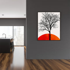 Illustration print by Kubistika, with black tree and dark orange sunrise, on light grey background; in dining room
