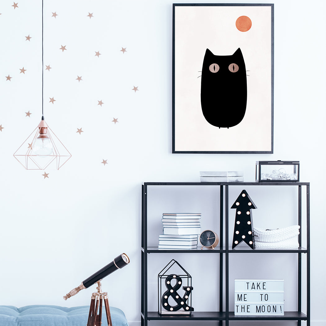 Poster print by Kubistika, with graphic black cat and orange moon, on light pink background; in teen's room