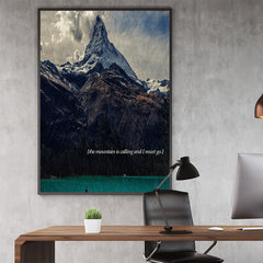 Photography poster print with an impressive mountain, turquoise blue lake and quote 'the mountain is calling and I must go'; in office