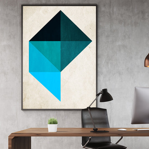 Geometric poster print by Kubistika, with blue shapes, on beige background; in office