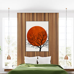Illustration print by Kubistika, with black tree and dark orange sun, on light grey background; in bedroom