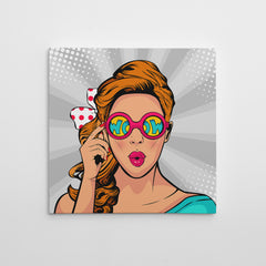 Square pop art canvas print with a girl with wow colourful sunglasses, on grey background.