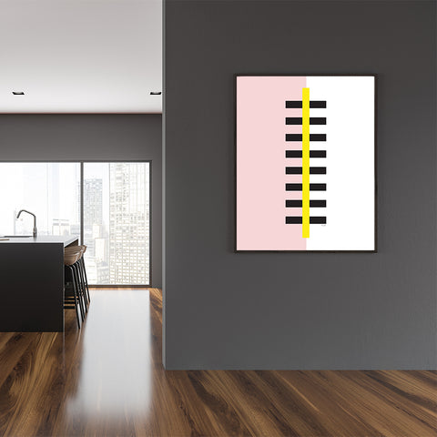 Graphic poster print by Linda Gobeta, with abstract yellow and black skyscraper, on pink and white background, dining room view