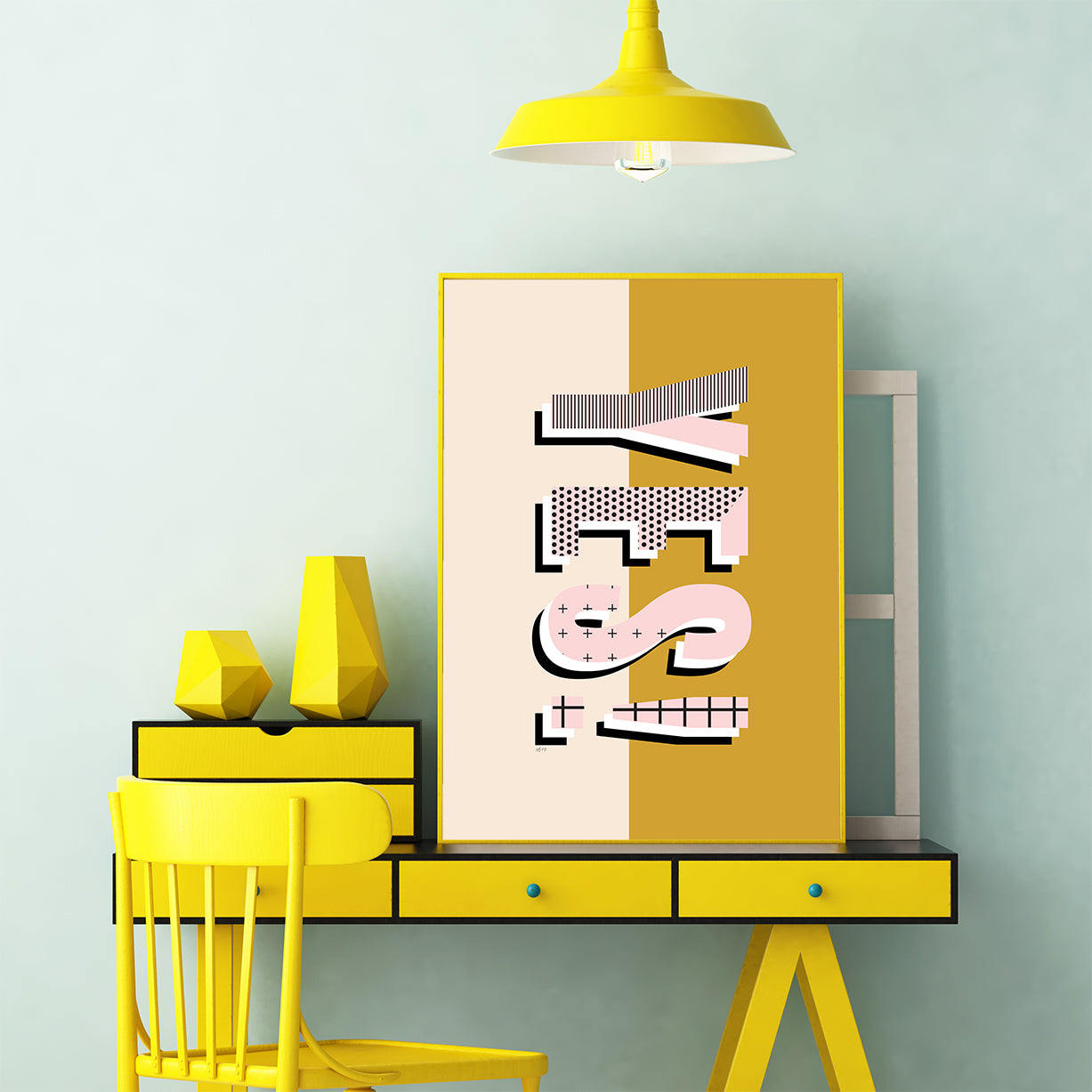 Typography poster print by Linda Gobeta, with ''YES!'' patterned in pink and black, on half mustard, half light pink background, office view