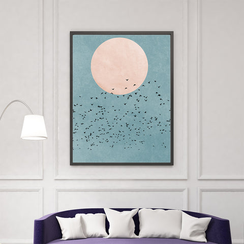 Minimalist textured poster print by Kubistika, with dusty pink sun and black birds, on dusty blue background, in living room
