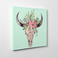 Canvas print with watercolour decorated bull skull on a light blue background - side view